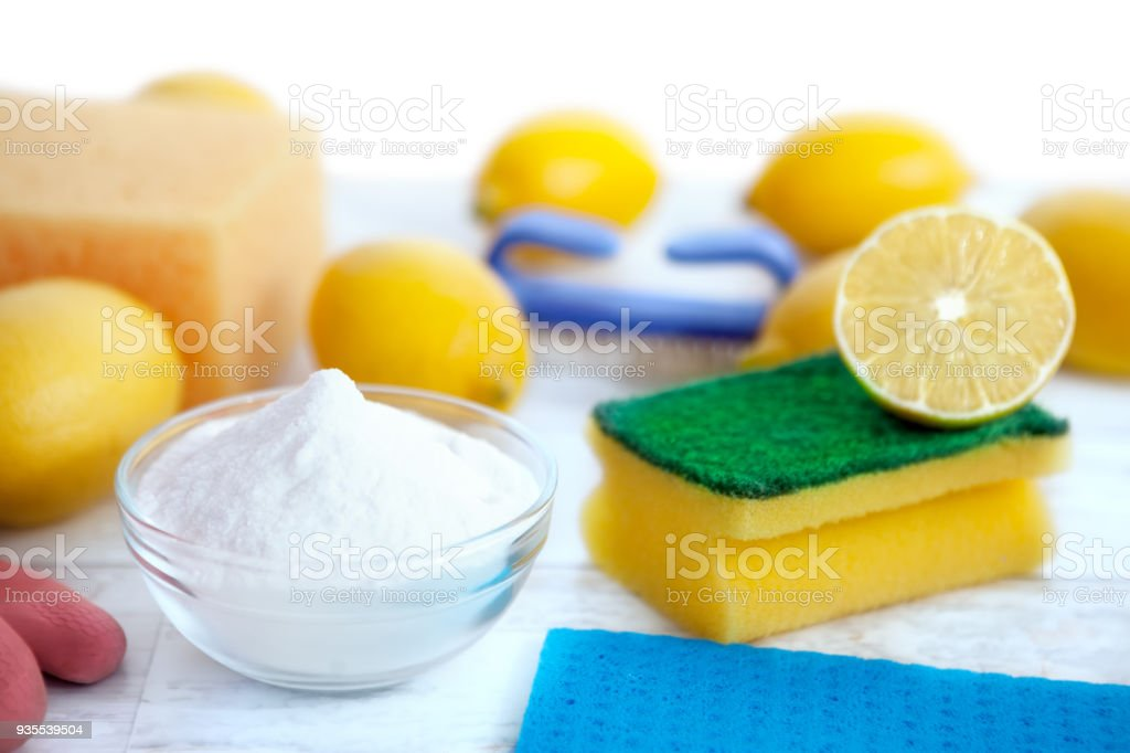 Cleaning accessories with baking soda and lemon stock photo