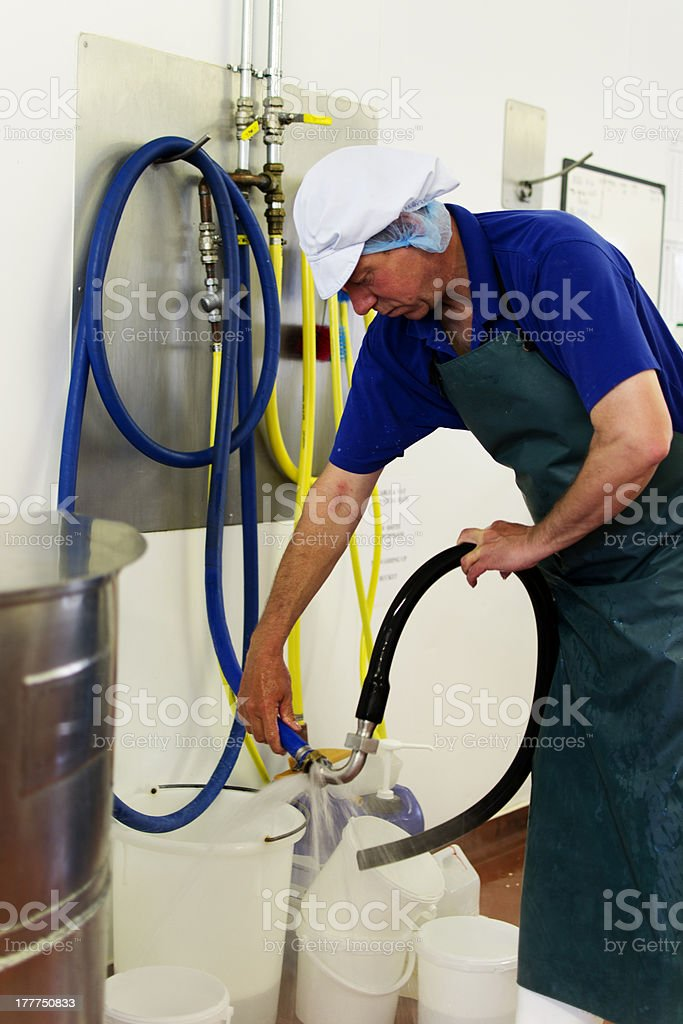 Cleaning after cheese production royalty-free stock photo