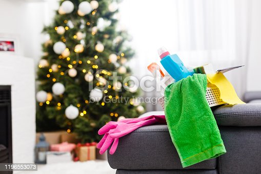 175392894 istock photo cleaning after Christmas party 1196553073