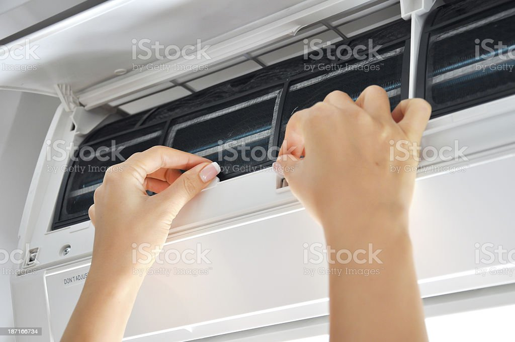 cleaning air conditioner filter stock photo