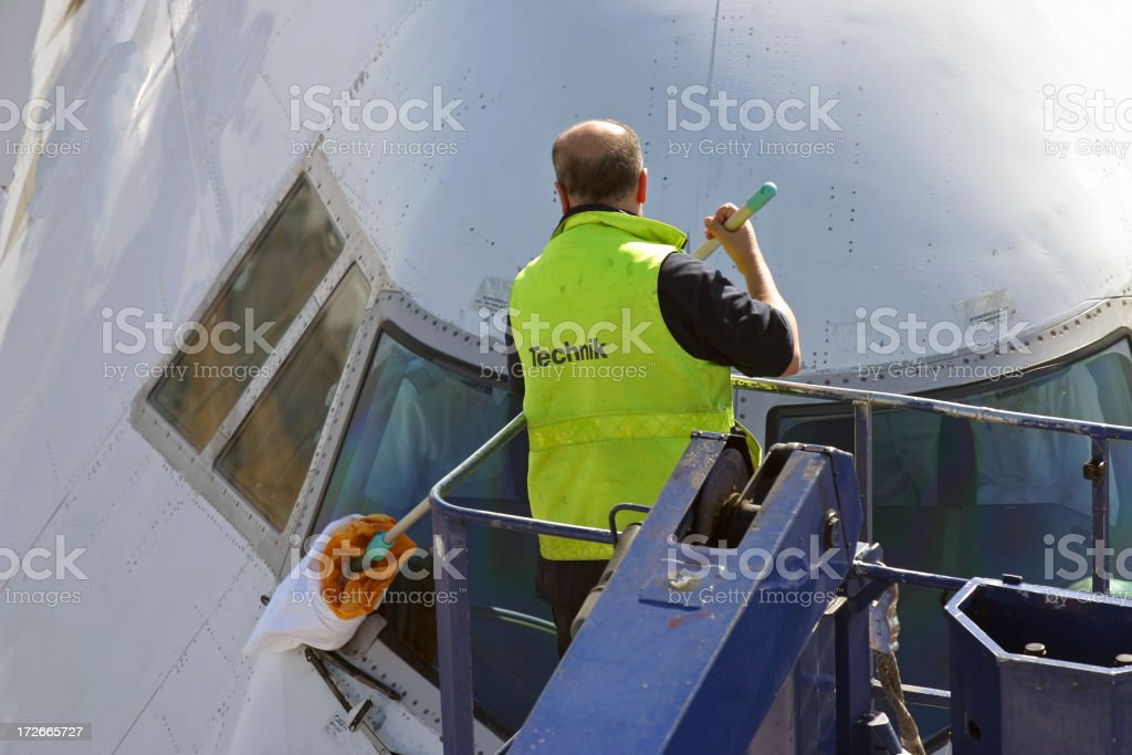 Cleaning an airplane´s cockpit window royalty-free stock photo