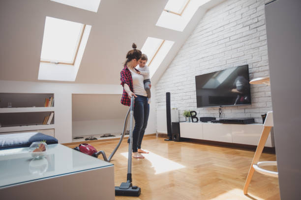 cleaning and babysitting - gender stereotypes stock photos and pictures