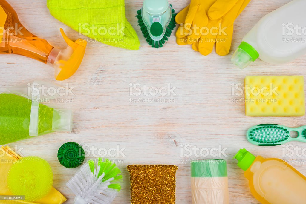 Cleaning and housework concept on wooden background, copyspace in center stock photo