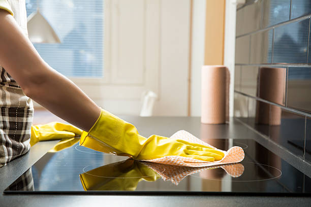 Cleaning and polish electric cooker stock photo