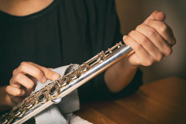 Cleaning And Polishing Flute With Rubbing Cloth stock photo