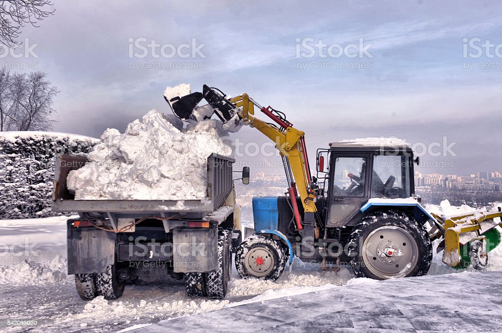 cleaning and snow loading on the truck stock photo