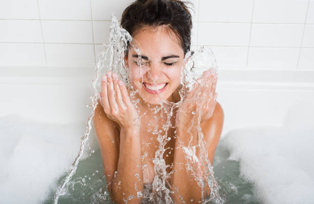 Cleaning and Splashing on Face  taking a bath stock pictures, royalty-free photos & images