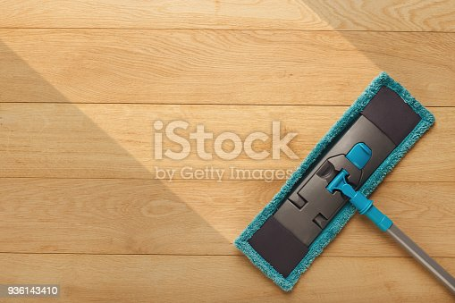 istock Cleaning background, mop washing wooden floor, before and after effect 936143410