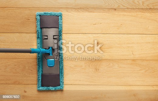 istock Cleaning background, mop washing wooden floor, before and after 939057632