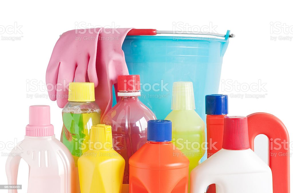 Cleaning bottles with a blue bucket and gloves royalty-free stock photo