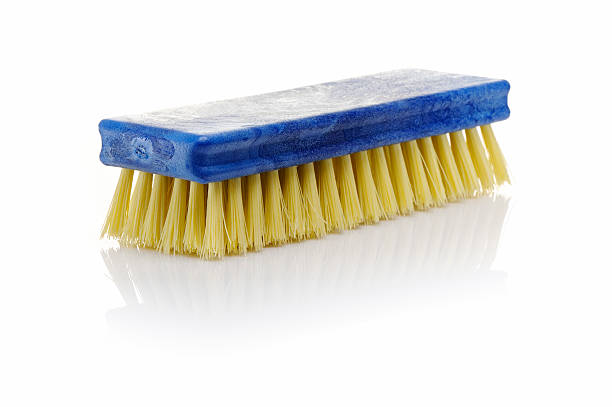 Cleaning brush Cleaning plastic brush isolated on white. More cleaning... scrubbing brush stock pictures, royalty-free photos & images