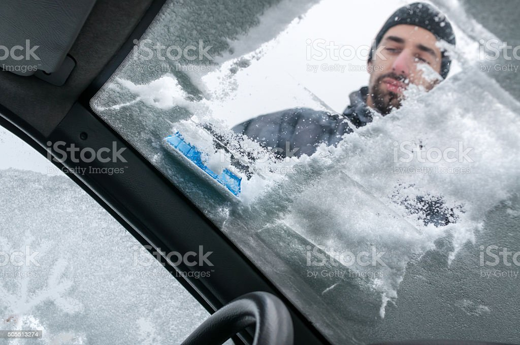 Cleaning Car From Snow stock photo