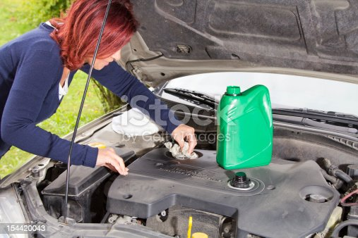 istock Cleaning car motor after adding oil 154420043