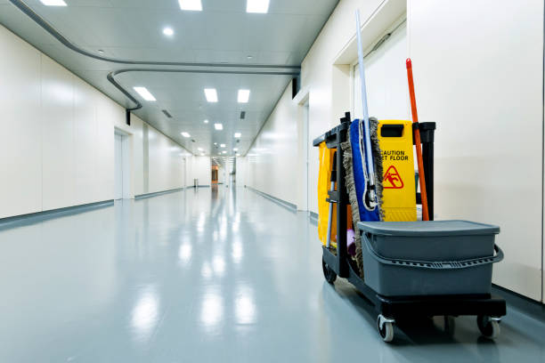 Cleaning cart in hospital corridor stock photo