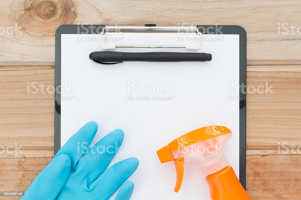 cleaning check list on wood table stock photo