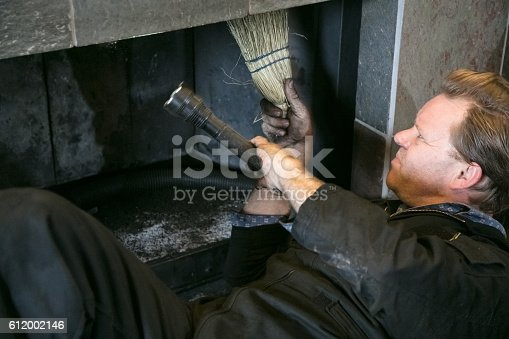 Chimney Sweep cleaning  fireplace inside of home