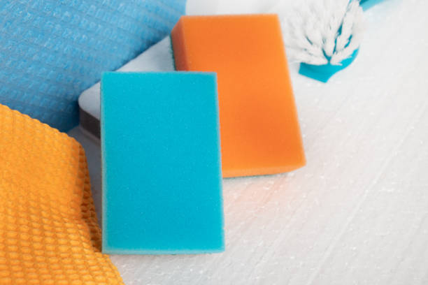 Cleaning company concept. Sponges, rags, brushes on a white background stock photo