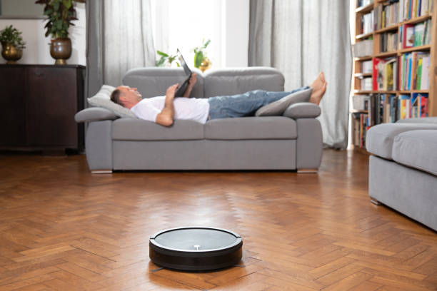 Cleaning concept - automatic robotic hoover clean the room – zdjęcie