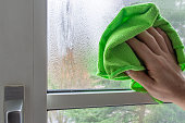 istock Cleaning condensate on a plasic framed window 1088117976