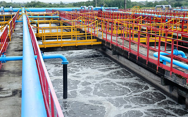 Cleaning construction for a sewage treatment Water treatment facility with large pools of water sewage stock pictures, royalty-free photos & images