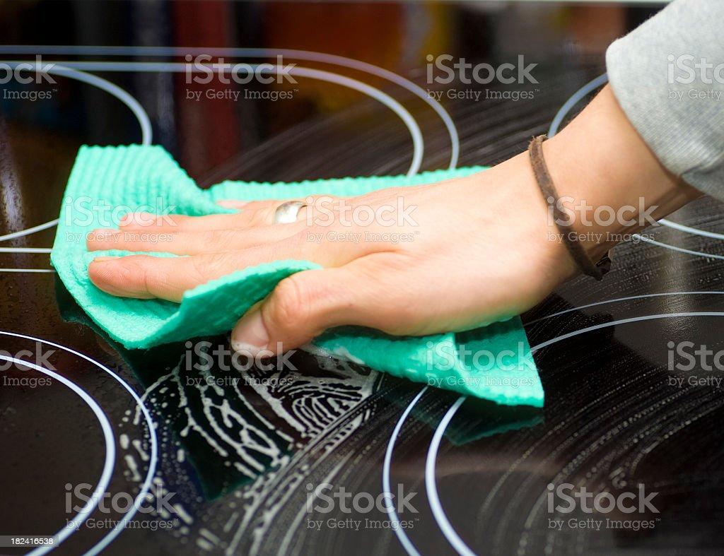 cleaning cookingfield - Cerankochfeld putzen stock photo