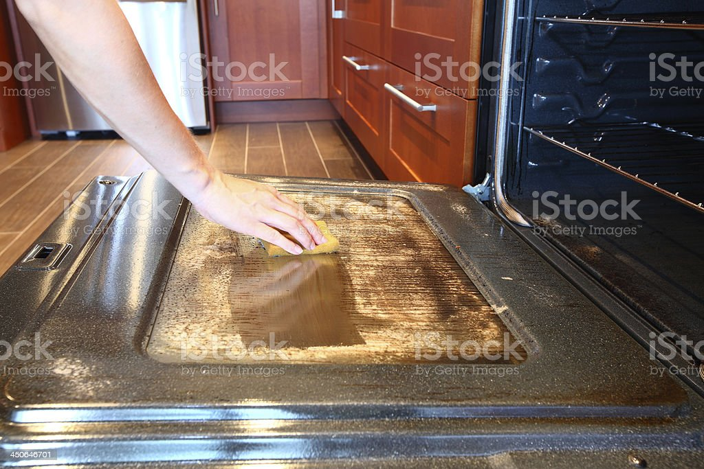 Cleaning dirty greasy oven stock photo