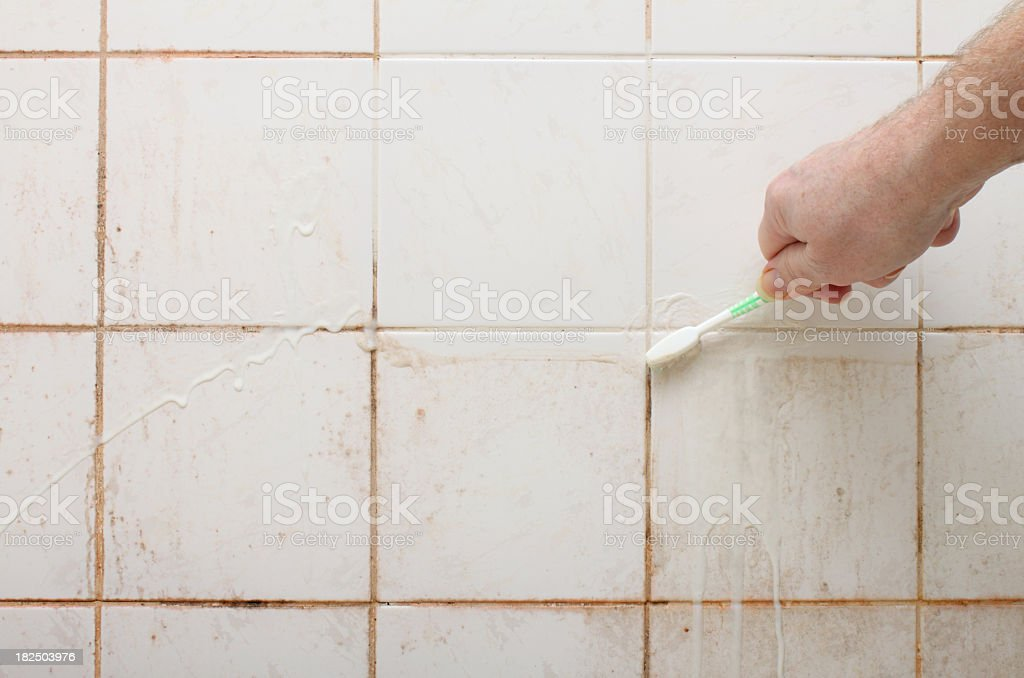Cleaning Dirty Shower And Bathroom Tiles With Mould Royalty Free Stock Photo