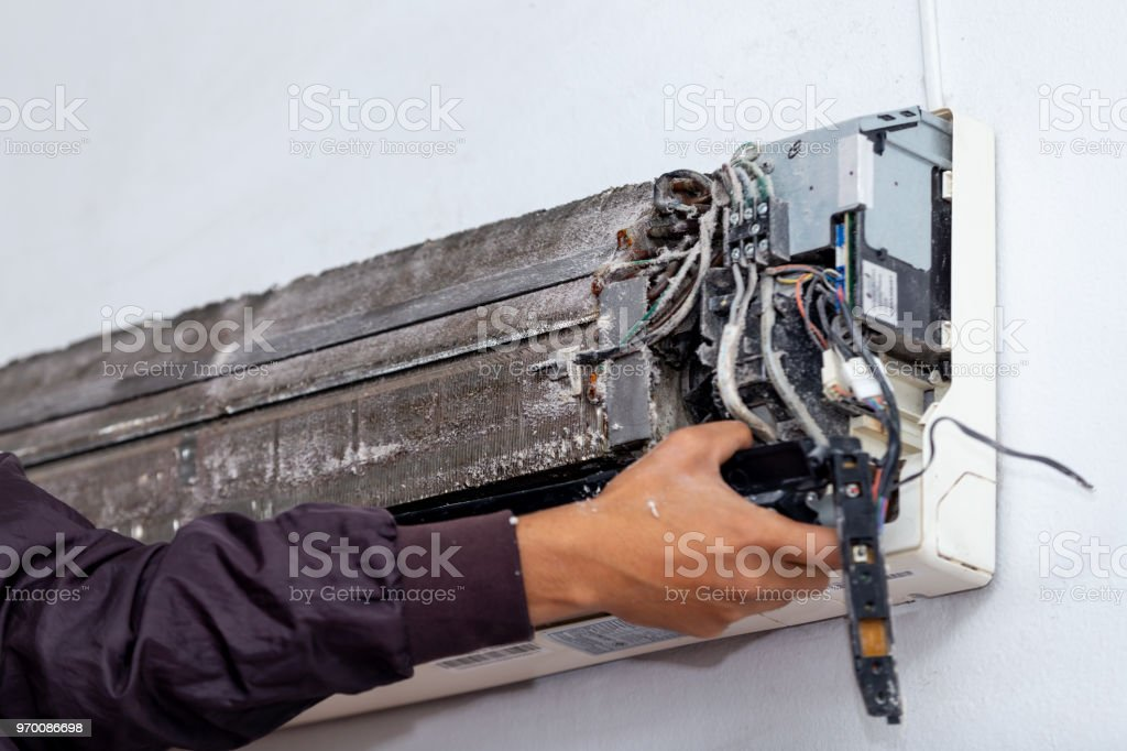 cleaning electrician air conditioner stock photo