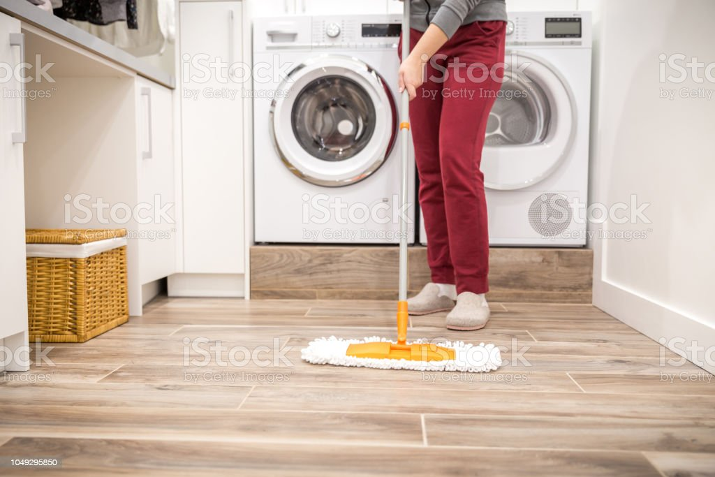 Cleaning floor in laundry room stock photo