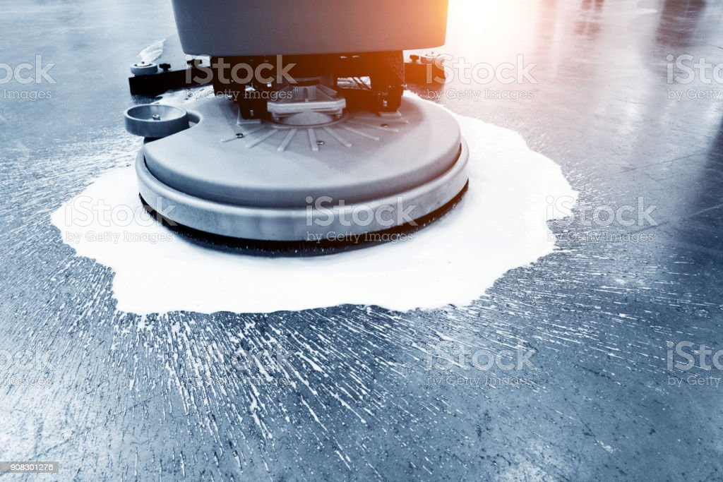 Cleaning floor with buffing machine stock photo