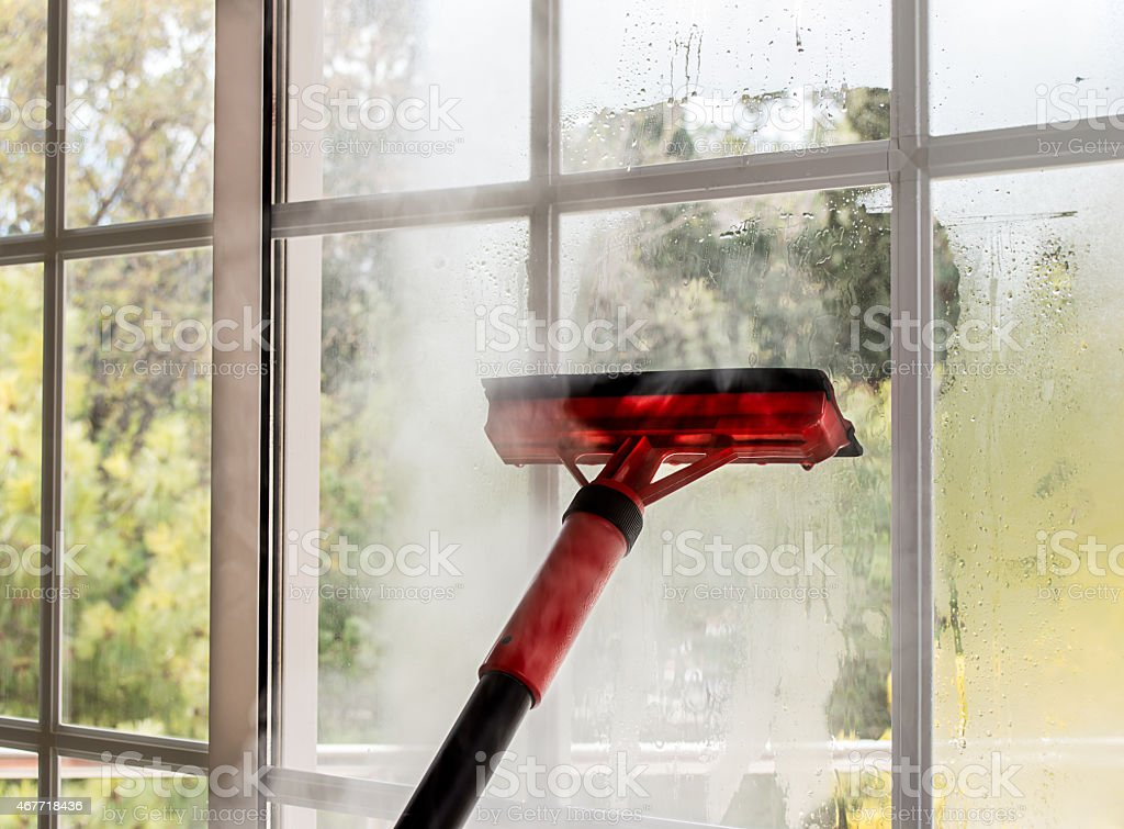 cleaning glass with steam stock photo