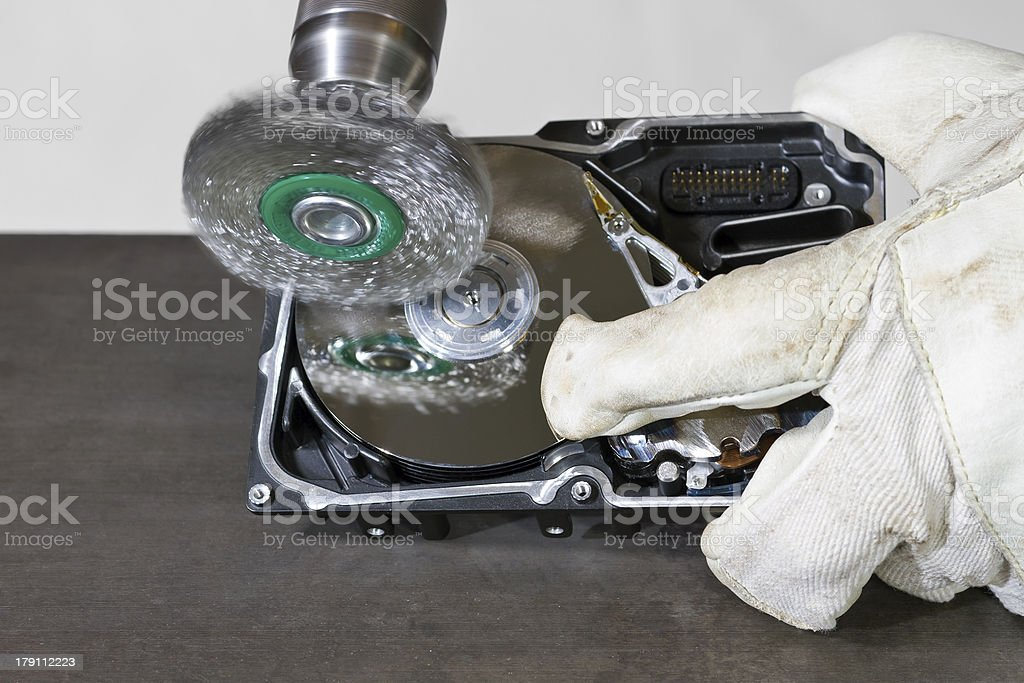 cleaning hard drive with electrical steel brush royalty-free stock photo