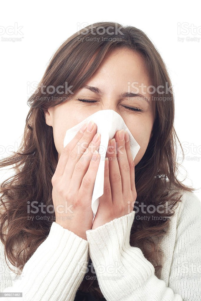 cleaning her nose with a tissue royalty-free stock photo