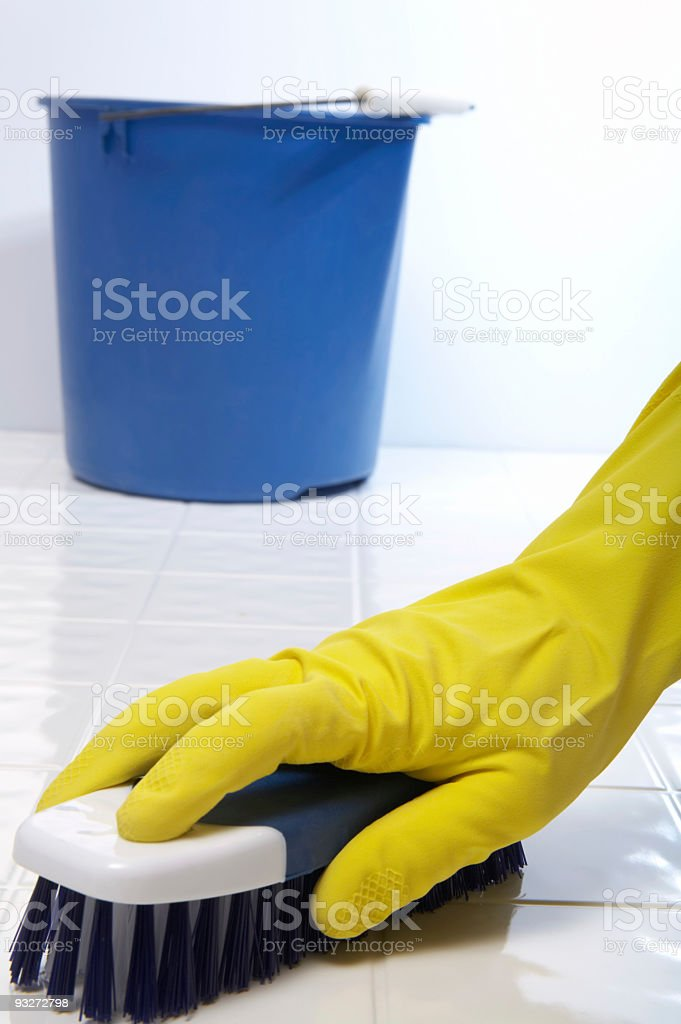 Cleaning House - Scrubbing the Floor royalty-free stock photo