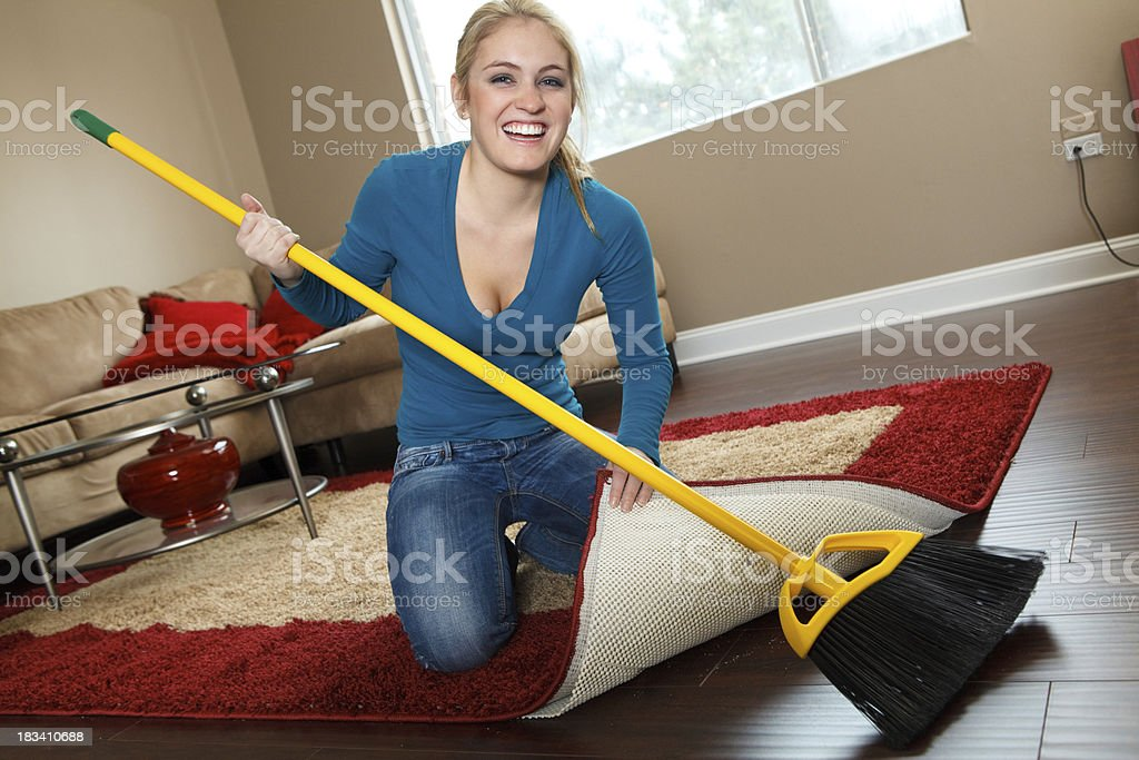 Cleaning House - Sweeping Dirt Under the Rug stock photo