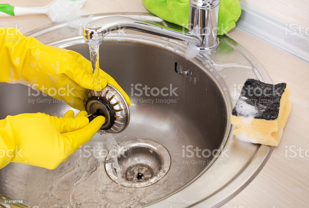 Cleaning kitchen sink and drain - Stock image . & Cleaning Kitchen Sink And Drain Stock Photo u0026 More Pictures of Adult ...