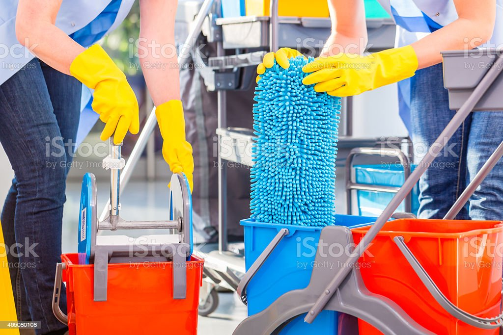 Cleaning ladies mopping floor stock photo