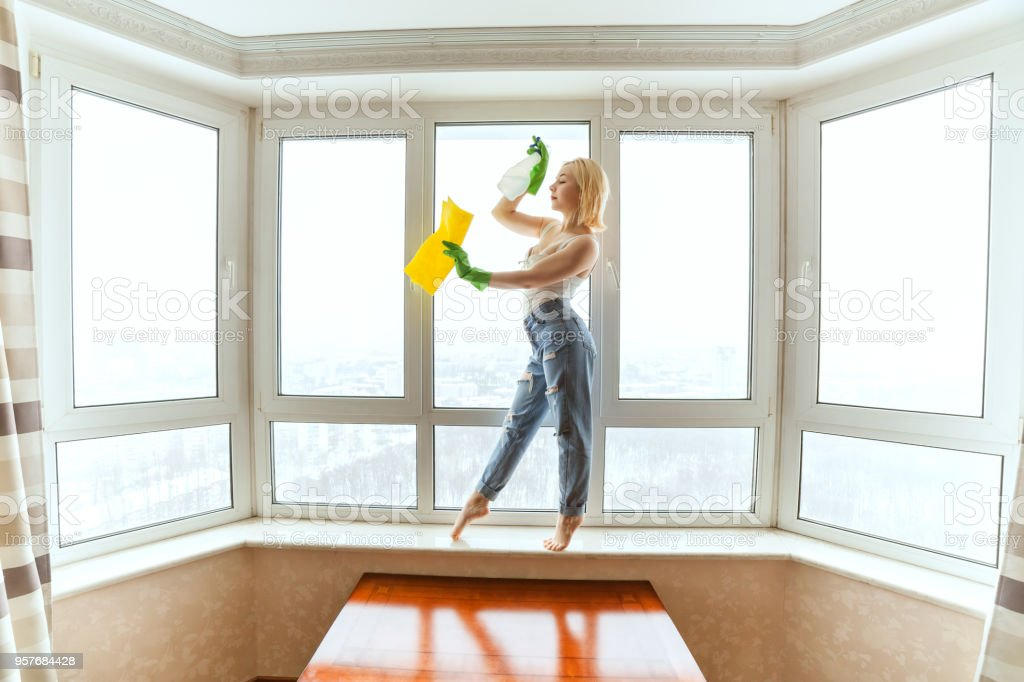 Cleaning lady is dancing. stock photo