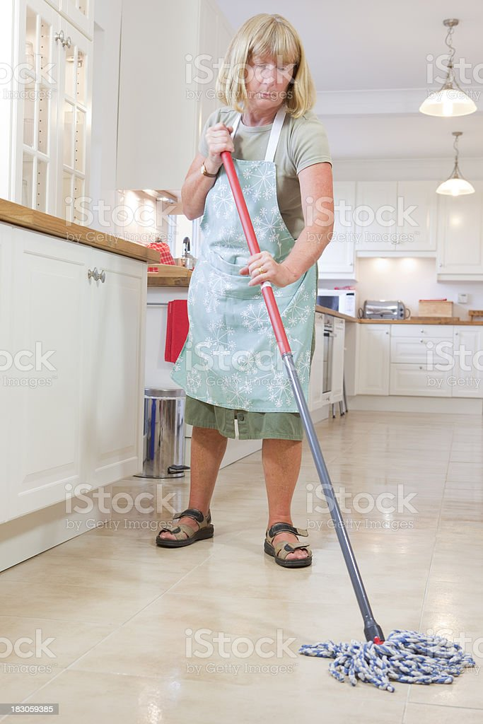 Cleaning Lady Mopping The Kitchen Floor Stock Photo & More Pictures ...