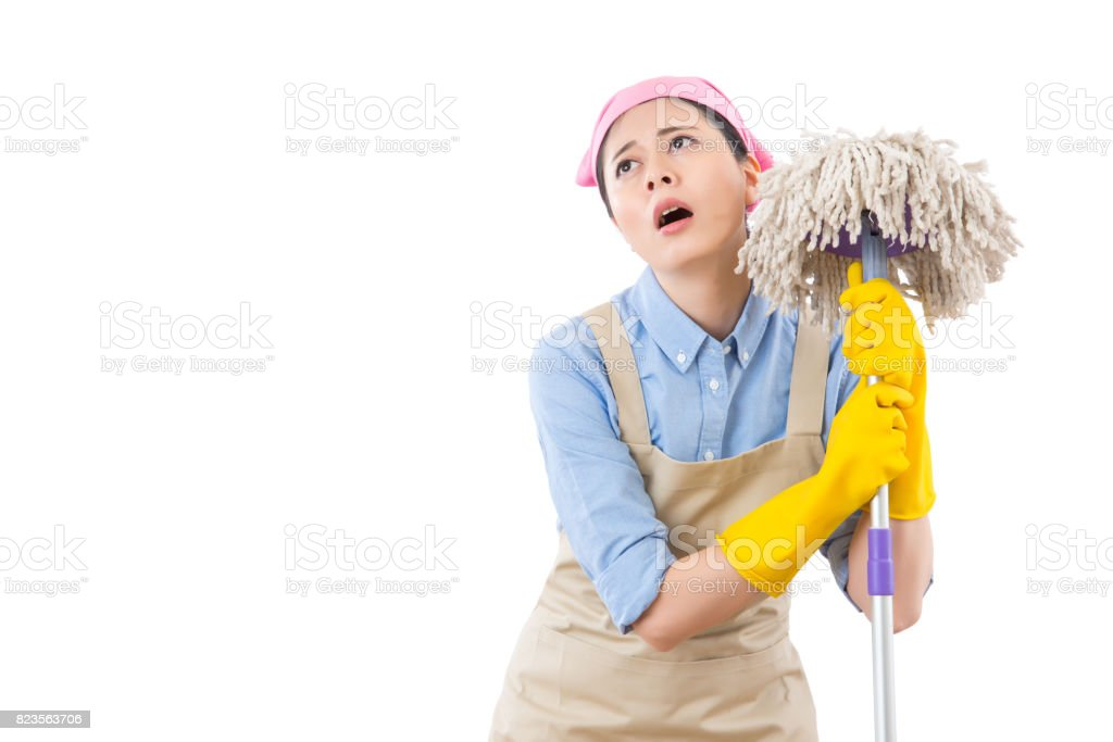cleaning lady overworked with house clean stock photo