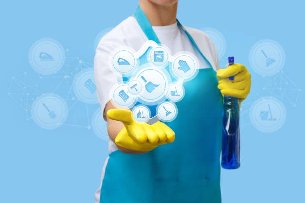 Cleaning lady shows cleaning services . stock photo