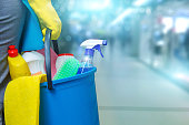 istock Cleaning lady with a bucket and cleaning products . 870219332