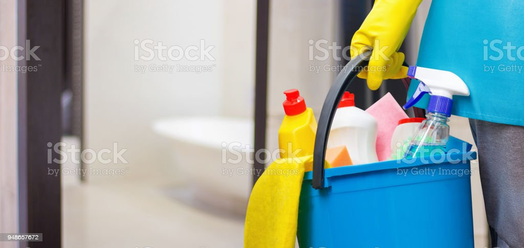 Cleaning lady with a bucket in hand . stock photo