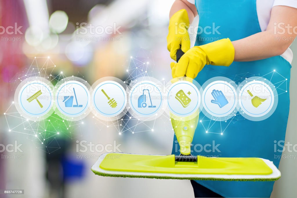 Cleaning lady with a MOP has shows the icons of the services. stock photo