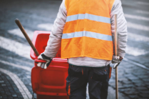 cleaning man is working on street in early morning. intended blurred and add noise image. cleaning man is working on street in early morning. intended blurred and add noise image. broom stock pictures, royalty-free photos & images