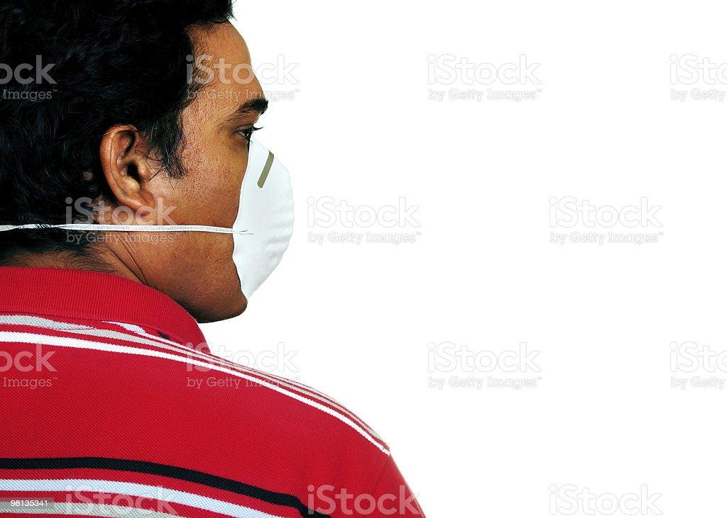 Pulizia uomo con maschera sul viso foto stock royalty-free