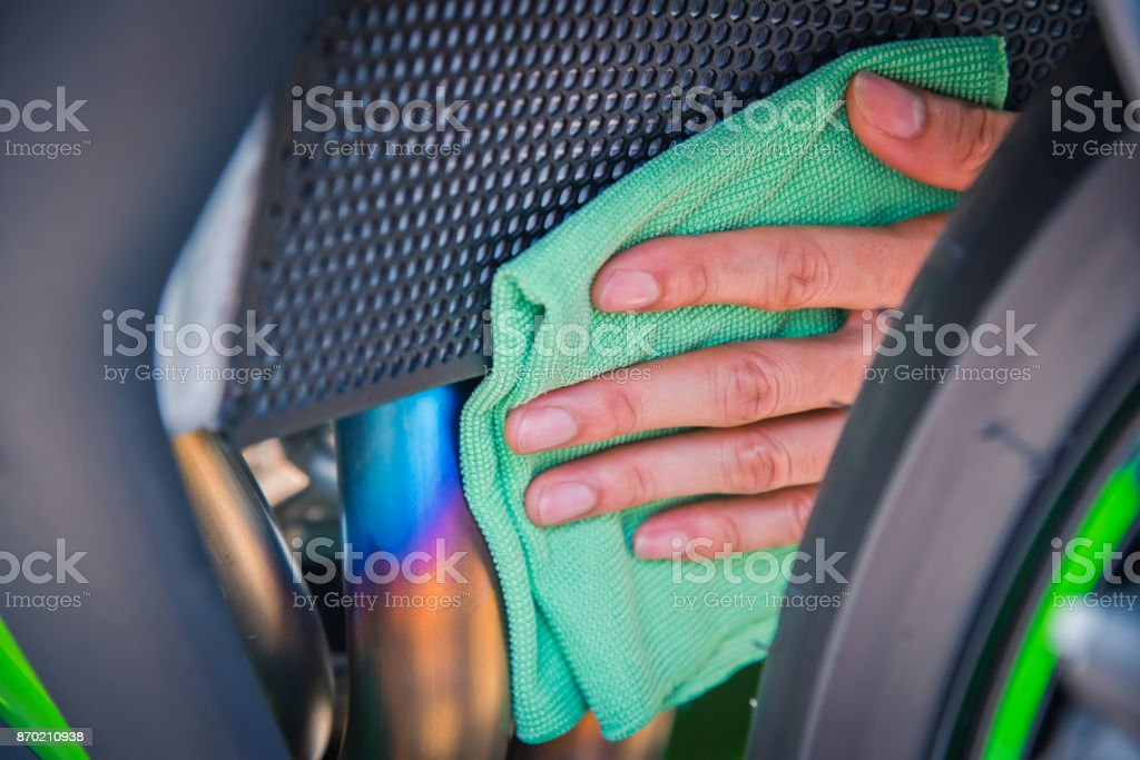 Cleaning motorcycle stock photo