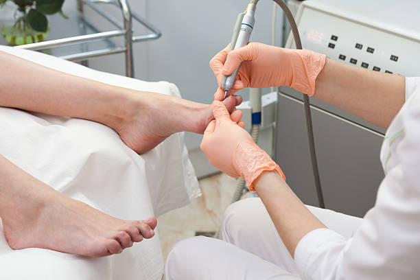 Cleaning of a foot. stock photo
