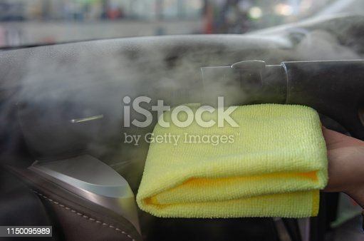 970100874 istock photo Cleaning of car air conditioner 1150095989