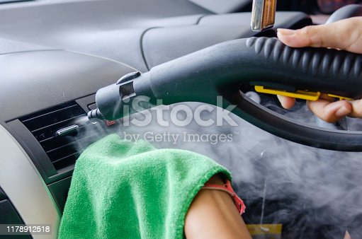 970100874 istock photo Cleaning of car air conditioner 1178912518